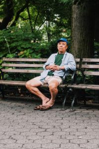 man resting on park bench