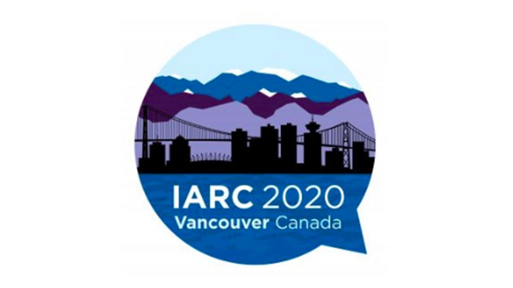 City skyline with IARC text